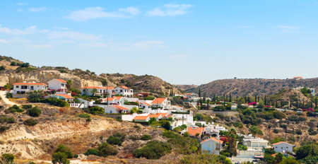 Typical Cypriot landscape, small houses with tiled roofs and mountains. Pissouri is a small coastal village located in the South-Western part of Cyprus Imagens