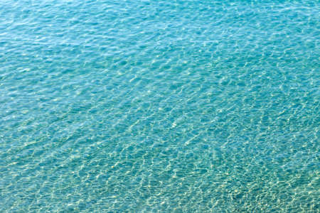 Clear, transparent turquoise water on the Mediterranean sea. Background image, texture Imagens