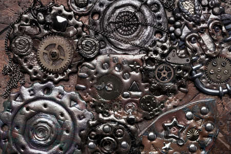 Composition of many brass gears of various sizes. Steampunk background