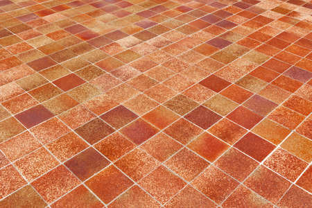 Big Red Luxury Ceramic Clinker Pavers for Patio. Original big floor pavers in a path, detail of a pavement to walk. Tiles of the square form