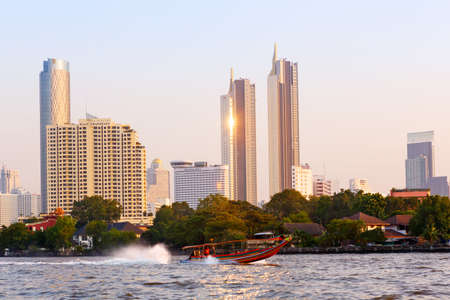 Bangkok, Thailand-3 December 2019: Beautiful, evening view of the Chao Phraya river and modern skyscrapers of Bangkok