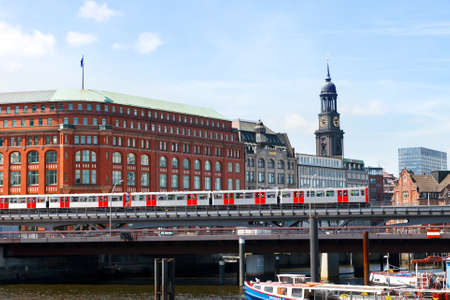 Hamburg, Germany-June 26, 2011:Hamburg subway train going over the bridge