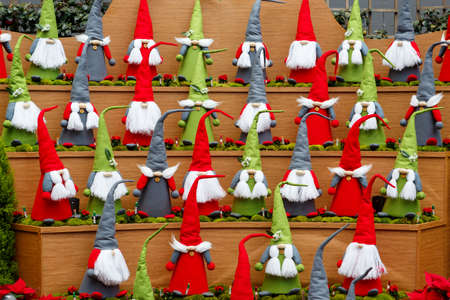 SINGAPORE-November 25, 2019: Group of multi-colored Santa Claus, Christmas decoration in Flower Dome, Gardens by the Bay