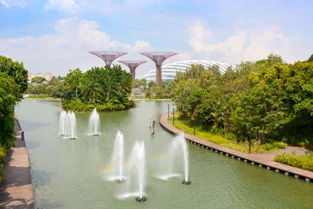 SINGAPORE-November 25, 2019:Fountains in Singapore's Marina Bay Park and Supertree Grove in the Garden by the Bay