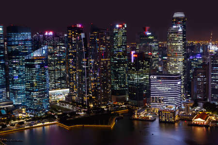 SINGAPORE-November 26, 2019: Skyscrapers of the business center of Singapore at night. Top view