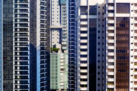 A fragment of modern, dense residential development. Urban landscape of solid buildings, walls and Windows Standard-Bild