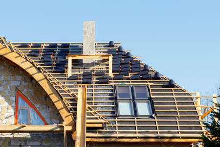 Repair of a roof made of ceramic tiles with skylight windows Standard-Bild