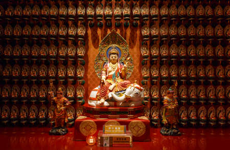 SINGAPORE-November 26, 2019: The Buddha statue inside Tooth Relic Temple located in the Chinatown district of Singapore Editorial