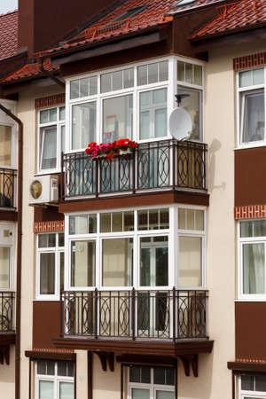 Glazed balcony in a modern apartment building. balcony with a metal wrought-iron lattice Standard-Bild
