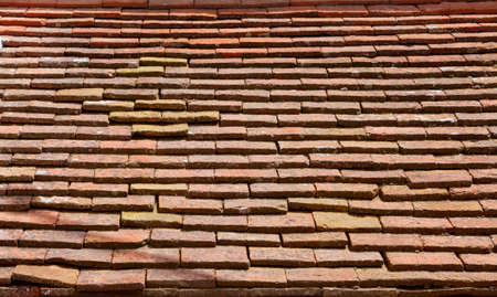 Old rectangular red ceramic tiles on the roof. Background image, texture