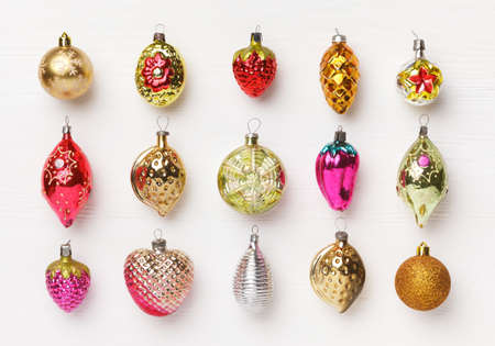 Antique Christmas toys on white wooden background. The concept of new year holidays. Flat lay, top view