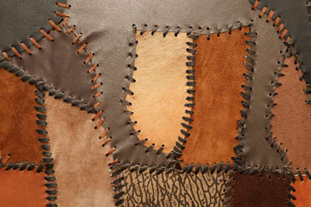 Pieces of genuine leather of different sizes and textures sewn together