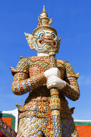 Demon Guardian close-up against a blue sky, in Wat Phra Kaew (Temple of the Emerald Buddha), Grand Palace in Bangkok, Thailand 報道画像
