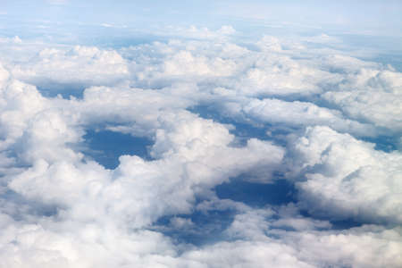 Fabulous, white clouds and blue sky. View from the airplane window 写真素材