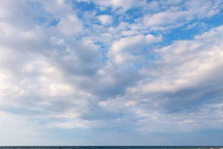 Fairy, beautiful white clouds against a blue sky. Soft focus Zdjęcie Seryjne