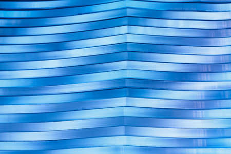 Surface, geometric pattern of the ends of thick glass. Blue glass background, diagonal lines and strips.