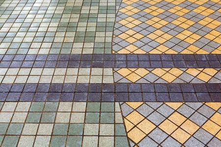 Beautiful pavement of gray and yellow clinker brick. Walking path