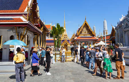 Bangkok, Thailand - December 02, 2019: Tourists visiting the Wat Phra Kaew, Temple of the Emerald Buddha, and Grand Palace complex 写真素材 - 158857267