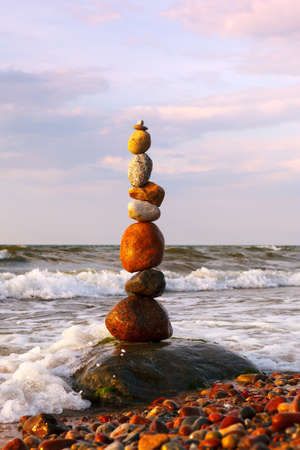Rock zen pyramid of colorful pebbles standing in the water on the background of the sea. Concept of Life balance, harmony and meditation 写真素材 - 159246082