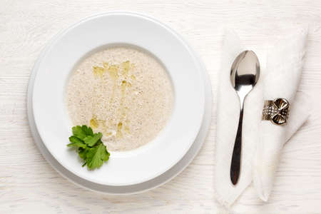 Mushroom soup puree in a white plate. Top view