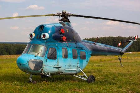 aerodrome: Blue helicopter on the aerodrome Stock Photo