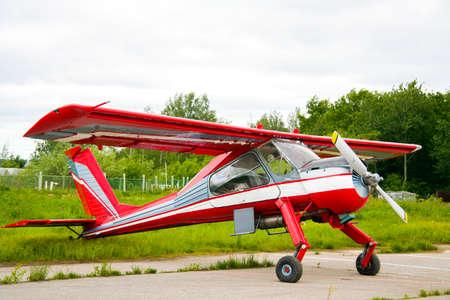 aerodrome: Red propeller plane on the aerodrome