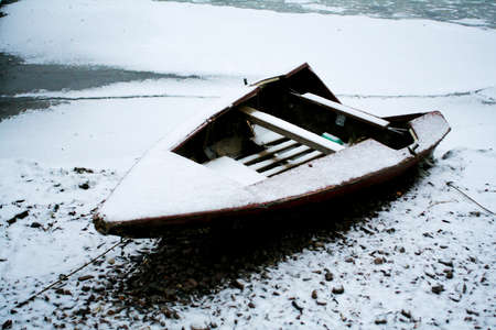 powdered: Boat powdered with snow