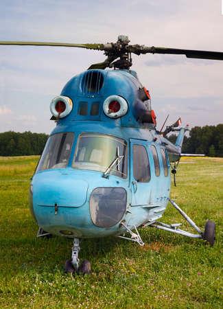 aerodrome: Blue helicopter on the aerodrome. Panorama Stock Photo
