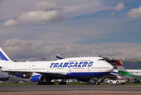 boeing: Moscow, airport Domodedovo - 27.09.2013: towing of Transaero Boeing 747-400