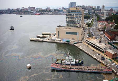 Vladivostok, Russia - August 20,2014 - Oil spills in water of Eastern Bosporus strait.