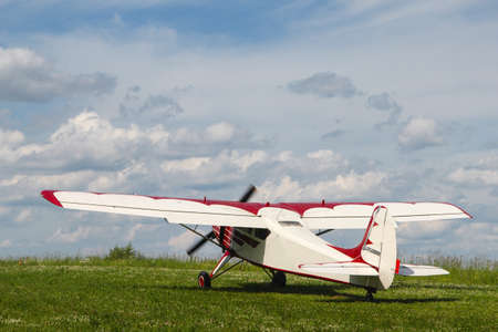 aerodrome: Propeller plane on the aerodrome on a cloudy sky background