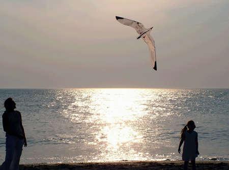 Two womens (family,sea,sunset,girl,women) Stock Photo - 403434