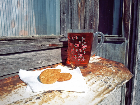 Country breakfast: cup of tea and almond cookies
