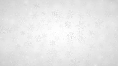 Christmas background of snowflakes of different shapes, sizes and transparency in gray and white colors