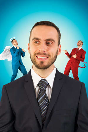 Businessman with angel and devil on his shoulders. Stock Photo