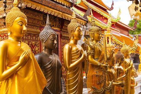 gold statues of Buddha in a temple Doi Suthep in Chiang Mai  Thailand   photo