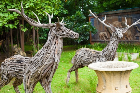 two deers made from pieces of wood photo