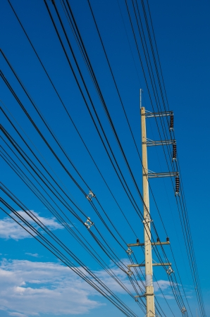 isolator insulator: electric pole with a transformer on a background of blue sky Stock Photo