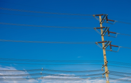 electric pole near a pond on a background of blue sky photo