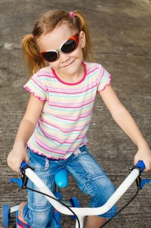 happy child on a bicycle Stock Photo - 16763941