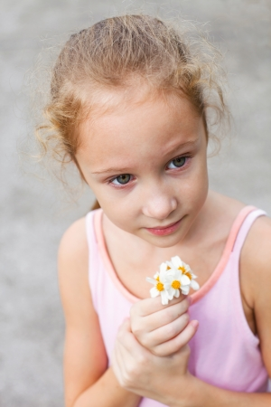 smiling girl with flowers camomile in her hands Stock Photo - 16825816