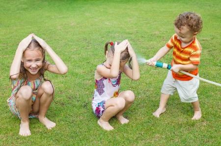 liquid summer: Happy children pours a water