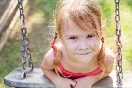 portrait of a happy little girl on a swing Stock Photo - 16847559