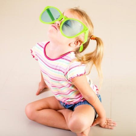 portrait of a little girl in big sunglasses Stock Photo - 16847574