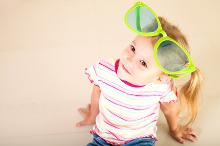 portrait of a little girl in big sunglasses Stock Photo - 16847571
