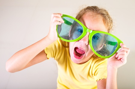 portrait of a little girl in big sunglasses Stock Photo - 16847558