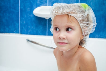 Cute four year old girl taking a relaxing bath. The symbol of purity and hygiene education. Stock Photo - 16907709