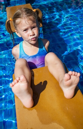 little girl in the pool photo