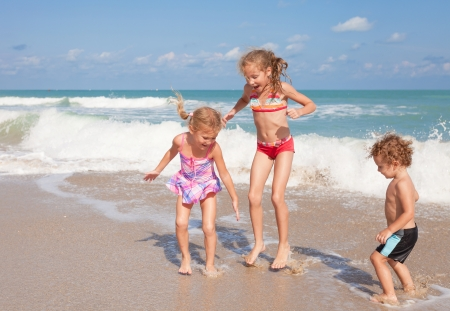 happy kids playing on beach photo