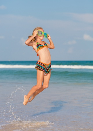 big: flying jump beach girl on blue sea shore in summer vacation